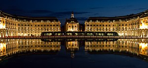 Reflecting pool - The Miroir d'eau by night in Bordeaux, France.