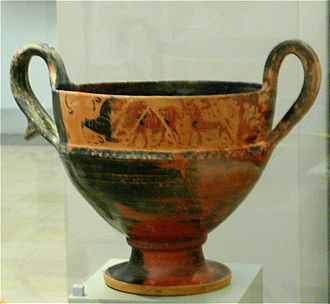 A misfired black-figure vessel, with reduction satisfactory only in the left part: the area on the right either reduced insufficiently or reoxidised due to insufficient sealing, perhaps as a result of uneven temperature distribution or bad circulation of reducing gases in the kiln. Misfired black-figured vase from Thebes.jpg