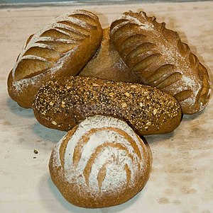 Rye, multi-grain and whole wheat bread loaves.
