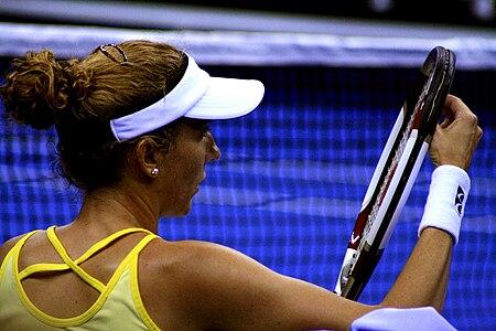Monica Adjusting Her Racket Strings.jpg