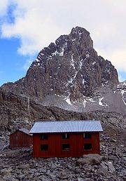 A view of the Austrian Hut on Mt Kenya with Nelion (5,188 m) in the background. The Normal Route up Nelion can be seen, but is not highlighted.