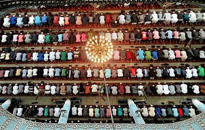 Prayer - Muslim men prostrating during prayer in a mosque
