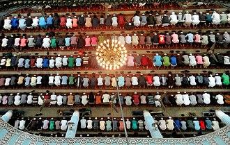 Prayer - Muslim men prostrating during prayer in a mosque