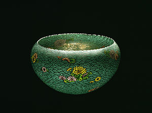 Plique-à-jour - Bowl with plique-à-jour enamelling on a silver base. The silver has been cut into a pattern of stylized waves with floating chrysanthmum blossoms. By Namikawa Sōsuke, Meiji era, c. 1900
