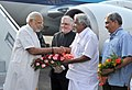 Narendra Modi being received by the Governor of Kerala, Justice (Retd.) P. Sathasivam, the Chief Minister of Kerala, Shri Oommen Chandy and the Union Minister for Defence, Shri Manohar Parrikar, on his arrival in Kochi (1).jpg