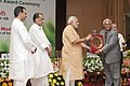 Narendra Modi presenting the NASI-ICAR Award for innovation and research on Farm Implements 2013 to the Central Agricultural University, Imphal, at the 86th Foundation Day of ICAR and ICAR award presentation ceremony.jpg