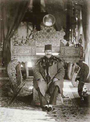Sun Throne - Naser al-Din Shah seated on the steps of the Sun Throne in the Mirror Hall of Golestan Palace