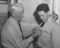 Nimitz Presents Navy Cross to John A Scott.tiff
