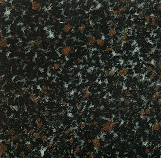 "Amphibolite - Garnet amphibolite, sold as ""Nordic Sunset Granite"", reportedly from  Murmansk area."