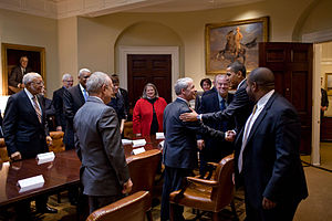 White House Office of Faith-Based and Neighborhood Partnerships - President Barack Obama greets and thanks members of the President's Council on Faith-Based and Neighborhood Partnerships during a drop by in the Roosevelt Room of the White House, March 9, 2010.