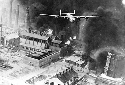 American B-24 Liberator flying over a burning oil refinery at Ploiesti, as part of Operation Tidal Wave on 1 August 1943. Due to its role as a major supplier of oil to the Axis, Romania was a prime target of Allied strategic bombing in 1943 and 1944. Operation Tidal Wave in 1943.jpg