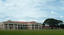 Part of the Malay College Kuala Kangsar buildings with its football field in the foreground.