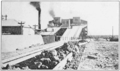 PSM V83 D223 Cars of caliche empty their loads in the maquina on top of the incline.png