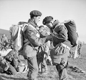 4th Parachute Brigade (United Kingdom) - Paratroopers adjust their parachute harnesses during a large-scale airborne forces exercise, 22 April 1944.