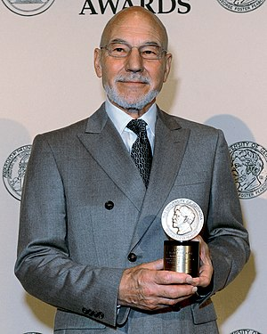 English actor Sir Patrick Stewart, seen here as the MC at the 71st Peabody Awards luncheon. Stewart's career has included roles on stage, television, and film. He has appeared for the Royal Shakespeare Company as well as in science fiction series such as Star Trek and X-Men.