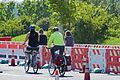 People riding bikes and pedestrians use separate lanes through the work zone (27114323525).jpg