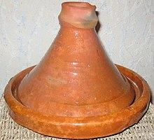 http://upload.wikimedia.org/wikipedia/commons/thumb/d/db/Plat_%C3%A0_Tajine.jpg/220px-Plat_%C3%A0_Tajine.jpg