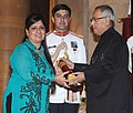 Pranab Mukherjee presenting the Padma Bhushan Award to Smt. Savita Bhatti on behalf of her husband late Shri Jaspal Singh Bhatti, at an Investiture Ceremony-II, at Rashtrapati Bhavan, in New Delhi on April 20, 2013.jpg