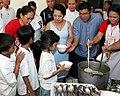 President Gloria Macapagal-Arroyo during a feeding program.jpg