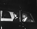President John F. Kennedy and First Lady Jacqueline Kennedy in car.jpg