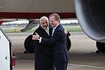 Prime Minister Narendra Modi is greeted by Minister of State for the Foreign and Commonwealth Office, Hugo Swire.jpg