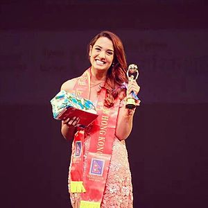 Priyanka Karki winning INFA Most Popular Actor (Female) 2014.jpg