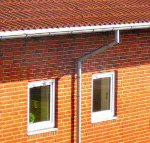 Eaves - Typical eaves overhang, shown here with a fascia board and gutter