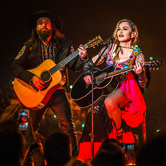 Who's That Girl (Madonna song) - Madonna performing an acoustic version of the song during the Rebel Heart Tour (2015–16).