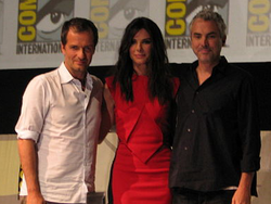 Photograph of producer David Heyman, actress Sandra Bullock and director Alfonso Cuarón attending San Diego Comic-Con in 2013