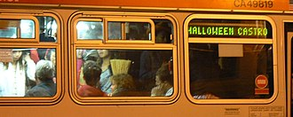 """Halloween in the Castro - 2006, the last year of the large organized street party, a crowded city bus with the destination """"Halloween Castro."""""""