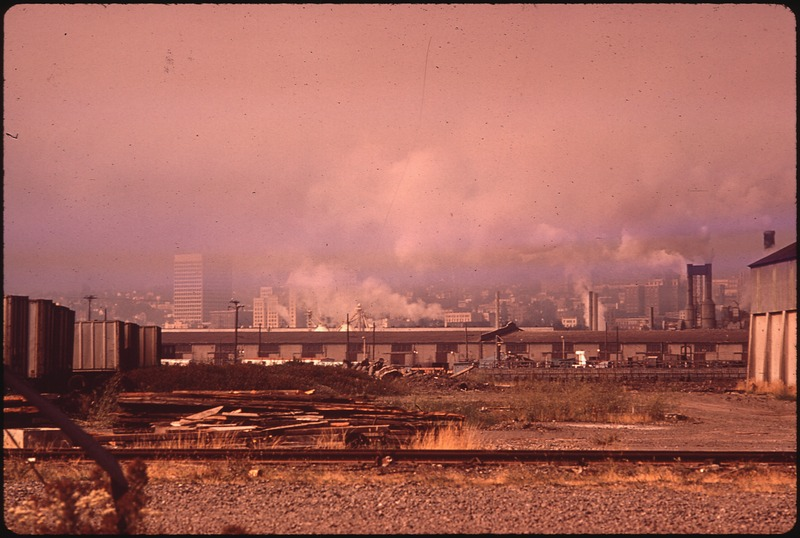 SMOG HANGS OVER WATERFRONT AREA, WITH TACOMA SKYLINE IN BACKGROUND - NARA - 545265