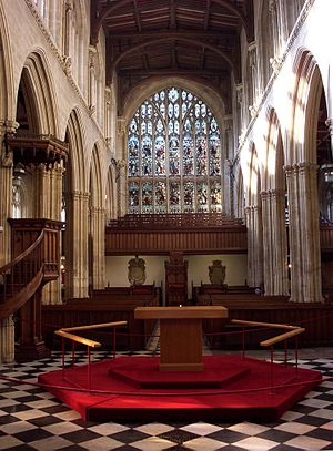 University Church of St Mary the Virgin - Nave viewed from the chancel looking west, the canopied pulpit can be seen on the left and the Chancellor's throne under the west gallery in the distance.