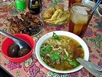 A selection of Indonesian food, including Soto...
