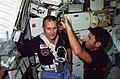 STS-5 Lenoir cuts Overmyer's hair.jpg