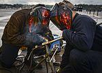 Sailors weld arresting cable 161002-N-DA275-083.jpg