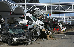 Sendai Airport - Vehicle debris on Sendai airport access road after tsunami