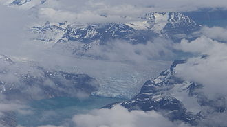 Kangerlussuatsiaq Fjord - Aerial view of Sermitsiaq Glacier flowing into two fjords at the same time: Kangaamiut Kangerluarsuat in the north (left) and Kangerlussuatsiaq in the south (right).