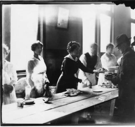 The strike committee set up soup kitchens and distributed as many as 30,000 meals each day. In the photo, a woman serves a plate of food to a striking worker. Serving Food Seattle Strike 1919.png