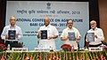 Sharad Pawar releasing a book, at the National Conference on Agriculture for Rabi Campaign-2013, in New Delhi. The Minister of State for Agriculture & Food Processing Industries, Shri Tariq Anwar is also seen.jpg
