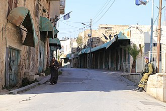 Al-Shuhada Street - Israeli checkpoint in Shuhada Street, guarding the Jews-only area. Palestinian house owners may enter by foot. (2012)