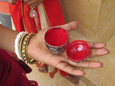 Sindoor, a traditional vermilion red or orange-red colored cosmetic powder.