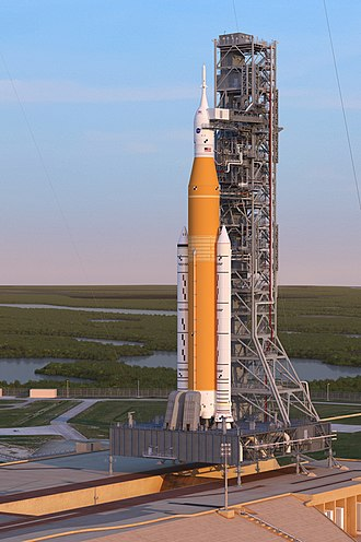 Space Launch System - Artist's rendering of the Space Launch System Block 1 sitting on Launch Pad 39B with the Orion spacecraft at sunrise.