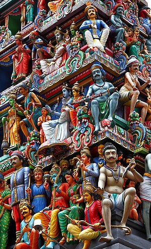 Group selection - Humanity has developed extremely rapidly, arguably through gene-culture coevolution, leading to complex cultural artefacts like the gopuram of the Sri Mariammam temple, Singapore.