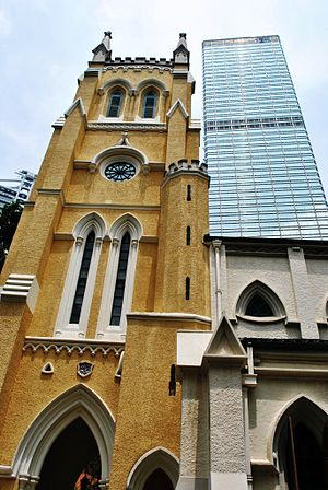 St. John's Cathedral (Hong Kong) - Church tower, east elevation, 2009 Cheung Kong Center in the background.