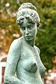 Statue of a young woman that looks cold (8338042771).jpg