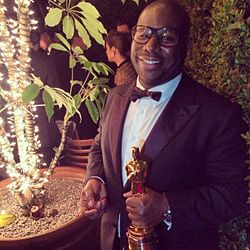 Steve McQueen holding the trophy for Best Picture Oscar for the film at the 86th Academy Awards