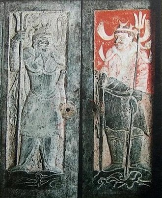 Tutelary deity - Stone doors of a tomb of the period of the Northern Dynasties to Tʻang Dynasty, excavated in Ching-pien County of the city of Yü-lin, Shensi Province. It shows two figures with tridents as the guardian deities of the tomb.