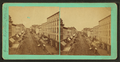 Street scene with buildings, trolley tracks, store fronts, and carriages, from Robert N. Dennis collection of stereoscopic views.png