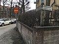 Street sign on wooden post (44660021825).jpg