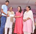 Student taking award from Chaudhary Birender singh and Hema Malini.jpg